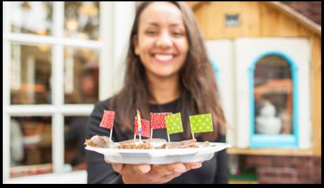 Girl holding welcoming cake